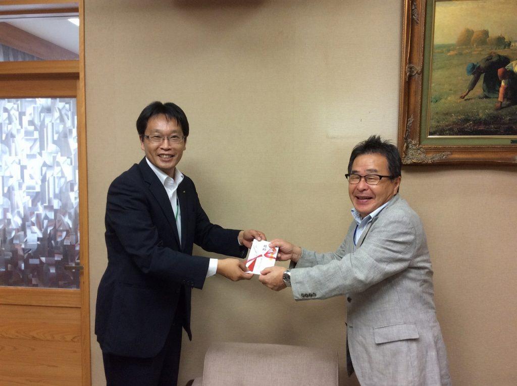 株式会社西日本セイムス代表取締役 田中 幸三様(左)と四万十川財団池田三男理事長(右)